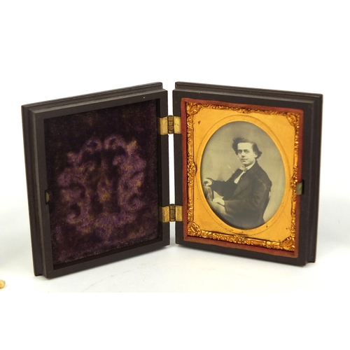 46 - Miscellaneous objects including a photograph of a gentleamn housed in a vulcanite case, celebration ...