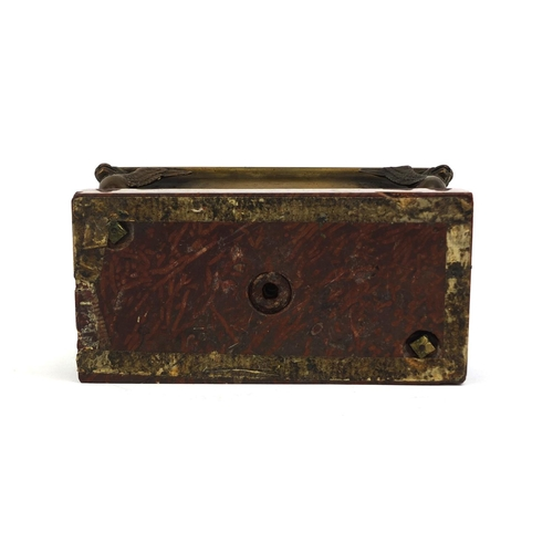 10 - Continental bronze twin inkwell with giffin supports, raised on a red marble base, 15cm high x 17cm ...