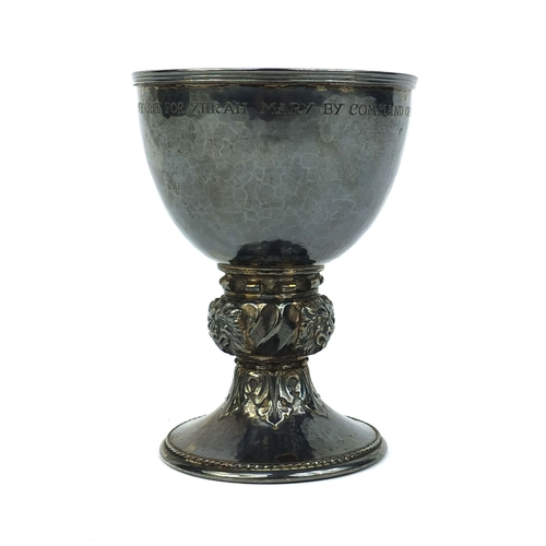 648 - Omar Ramsden silver chalice with planished decoration and lion mask stem, engraved Omar Ramsdon Me F...