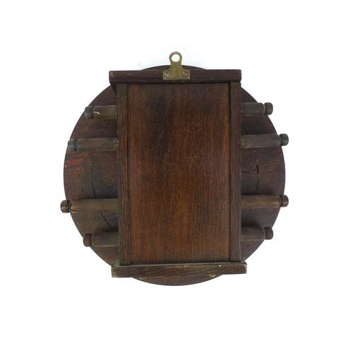 20 - Vintage circular oak wall day date calendar, 23cm in diameter...