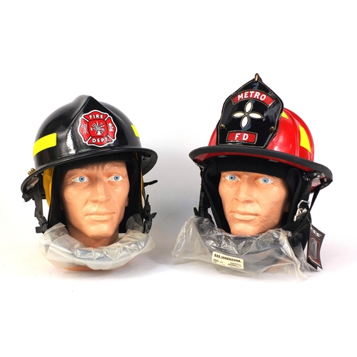 354 - Two American fire department helmets including one with Metro Fire Department leather badge, the lar...