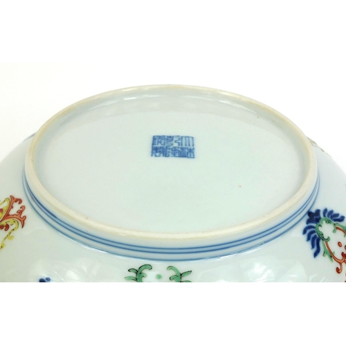 363 - Chinese porcelain shallow dish, hand painted in the Wucai palette with foliate scroll within blue ri...