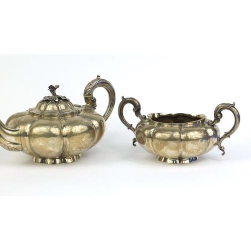 651 - Georgian silver three piece melon tea service,  C.G London 1837, the teapot 28cm long, approximate w...
