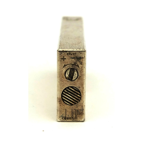 50 - Boxed Dunhill silver plated lighter with engine turned decoration, factory marks to the base, 7cm hi...