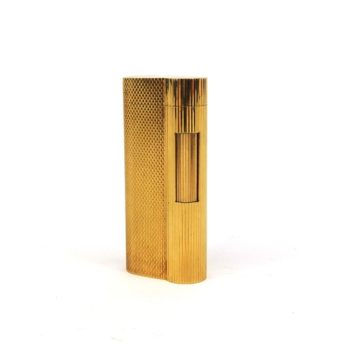51 - Dunhill gold plated lighter with engine turned decoration, factory marks to the base, 6.5cm high...