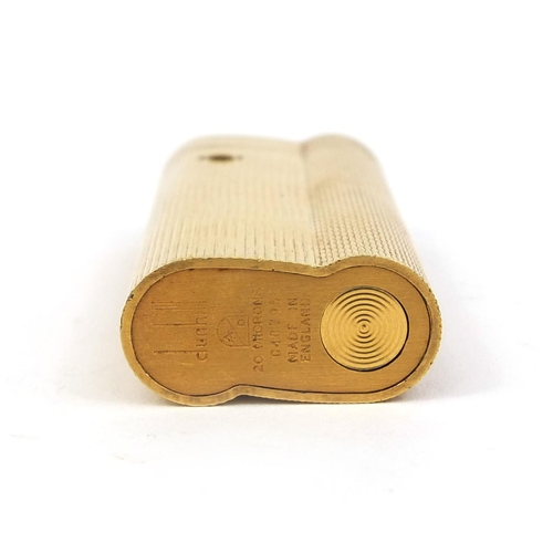 51 - Dunhill gold plated lighter with engine turned decoration, factory marks to the base, 6.5cm high