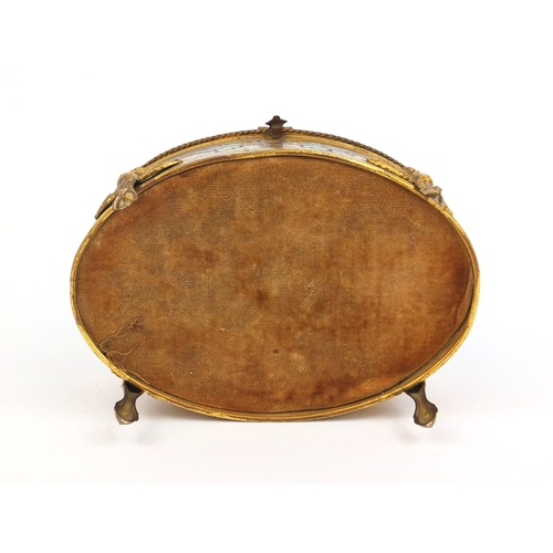 11 - Oval gilt brass and enamelled casket with bevelled glass and griffin legs, 10cm high x 16cm wide x 1...