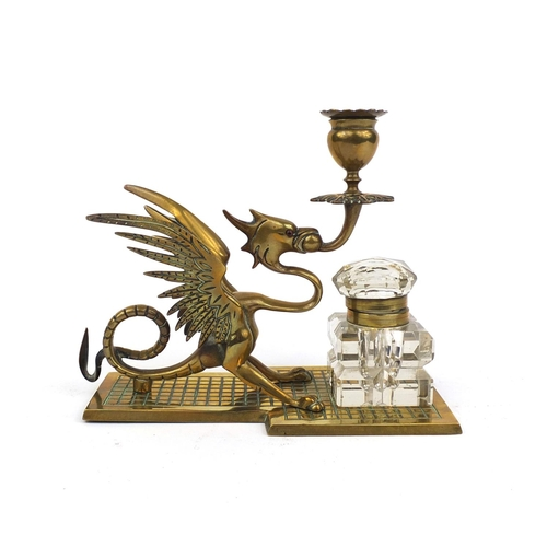 12 - Victorian brass candlestick desk stand, in the form of a dragon with glass inkwell, 18.5cm high