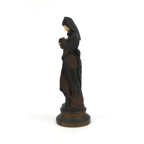 5 - Albert Ernest Carryer Belleuse, bronze and ivory study 'Liseuse' raised on a shaped base with plaque...