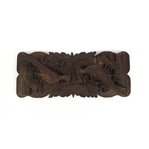 26 - Black forest extending book slide, the fold up ends carved with game, 39cm wide unextended