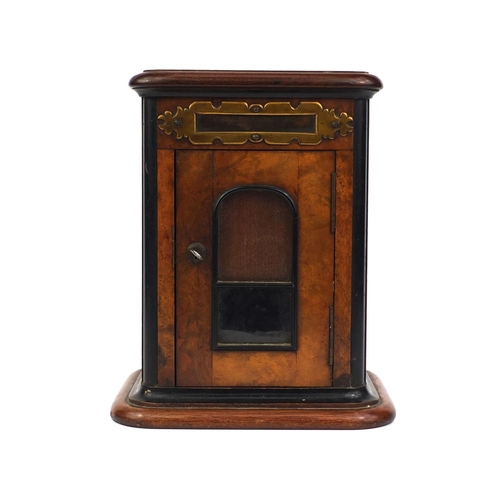 29 - Burr walnut and ebonised letterbox, with brass flap above a glazed door, 31cm high x 23cm wide x 17....
