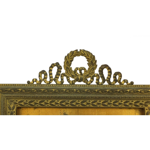 20 - Rectangular gilt brass easel photo frame with floral and wreath decoration, impressed AF to the ease...