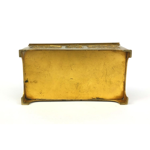 18 - 19th Century gilt brass casket with hinged lid, decorated with panels of stylised flowers and musici...