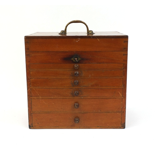 59 - The Dental Manufacturing Co of London mahogany dental case, with lift up top above six pull out draw...