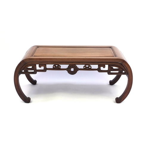 2003 - Chinese hardwood coffee table, rectangular top above a carved apron won C scroll legs, 40cm high x 9...