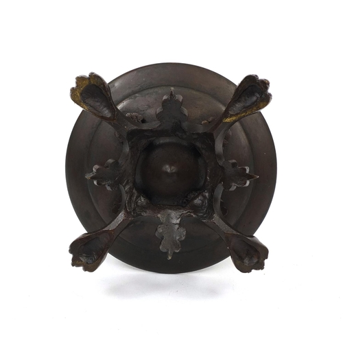 19 - Victorian bronze oil lamp with masks and lion paw feet, 25cm high