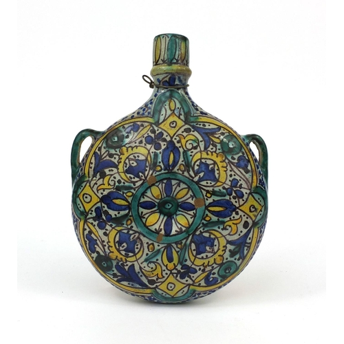 619 - Islamic iznik pottery flask with twin handles, hand painted with stylised flowers, 24cm high...