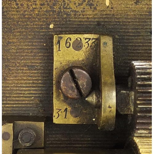 42 - Musical box movement housed in a glazed display case, the movement numbered 6233 31, the case 43.5cm...