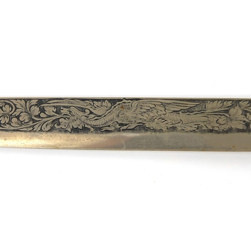 396 - Ivory handled steel knife profusely engraved with a dragon amongst flowers and foliate scrolls, 27cm...