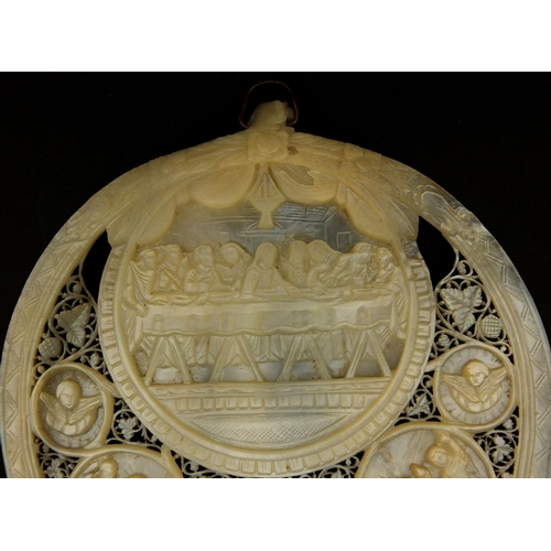 10 - Mother of Pearl shell carved with The Last Supper, profusely pierced with flowers and foliage, 16.5c...