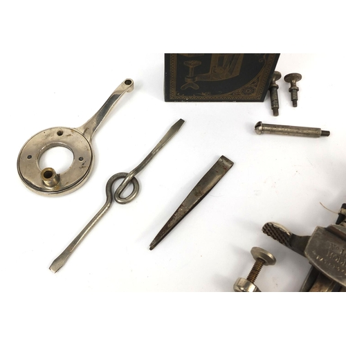 44 - The Moldacot sewing machine with accessories, tin and part box, the sewing machine numbered 11823, 1...
