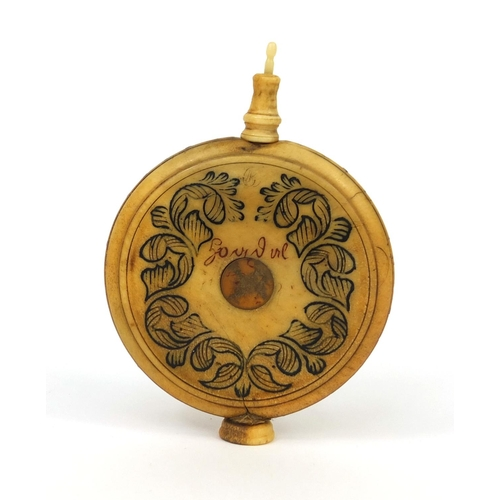 5 - 18th century circular bone scent bottle with floral pen work and brass studded decoration, dated 179...