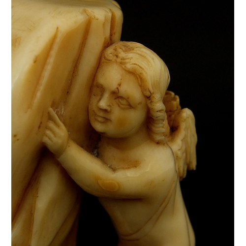 3 - Ivory carving of a Putti hiding behind a curtain, 7.2cm high