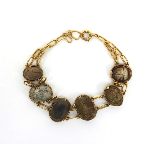 931 - Egyptian unmarked gold Scarab beetle bracelet, 22cm long, approximate weight 22.2g...