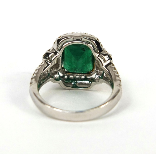 927 - 18ct white gold emerald and diamond ring, set with approximately ninety diamonds, size K, approximat...