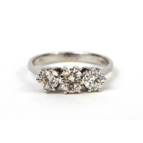 932 - 18ct white gold diamond three stone ring, size N, approximate weight 2.8g...