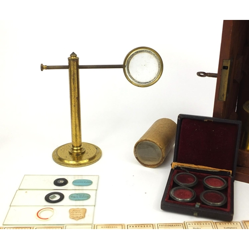 57 - Stanley of London adjustable brass microscope with fitted mahogany carrying box, together with vario...