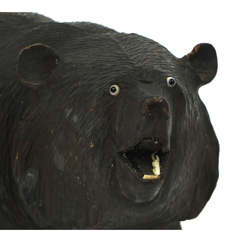 25 - Carved wooden bear with beaded eyes and bone teeth, 24.5cm in length