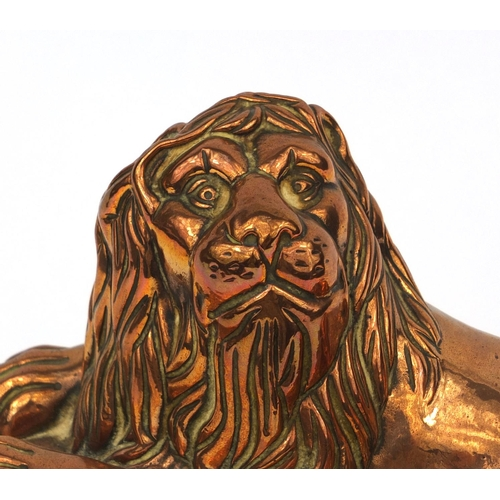 48 - Victorian copper jelly mould in the form of a recumbent lion, stamped R.V.2 to the rim, 17cm high