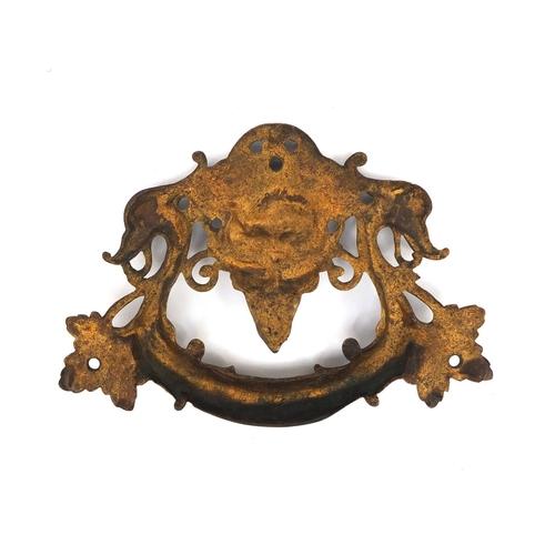 54 - Victorian bronze door handle with swan handle and grotesque face, 17.5cm wide