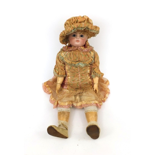 397 - Francois Gaultier bisque headed doll, wearing lace clothing, impressed FG10 to the back of the head,...