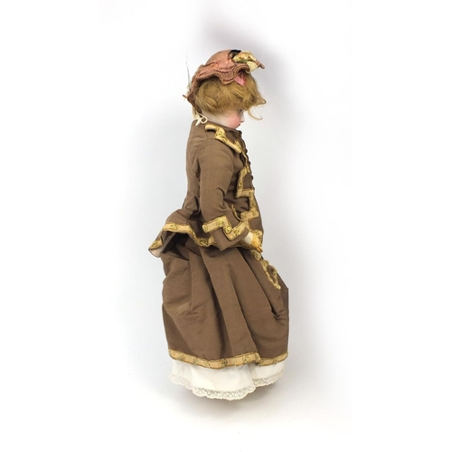 398 - Francois Gaultier bisque headed doll, wearing a traditional dress, impressed 7 to the back of the he...