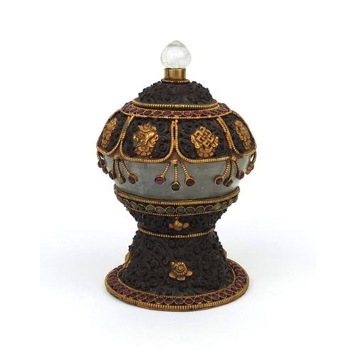 621 - Bhutan metal and rock crystal pot and cover with gilt mounts set with red and green stones, 18cm hig...