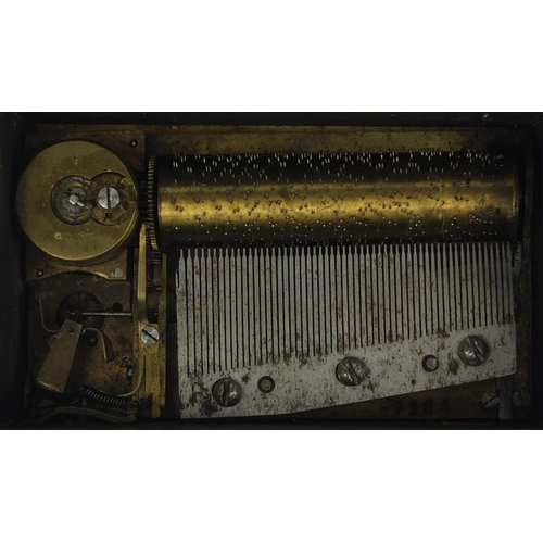 41 - Miniature yew music box, the hinged lid opening to reveal a brass cylinder playing on two airs, the ...