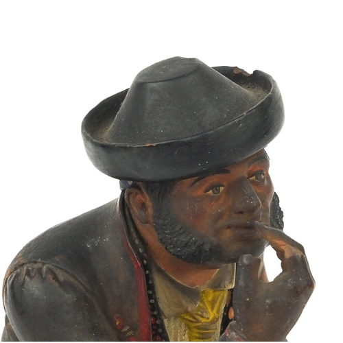 15 - 19th century Spanish polychrome painted terracotta figure of a seated pipe smoking gentleman, remnan...