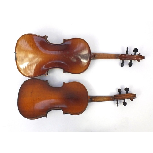 43 - Two old wooden violins, both with scrolled neck and ebonised pegs, the largest 66cm in length