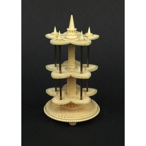 8 - Georgian turned and carved ivory three tier cotton reel stand, 17.5cm high