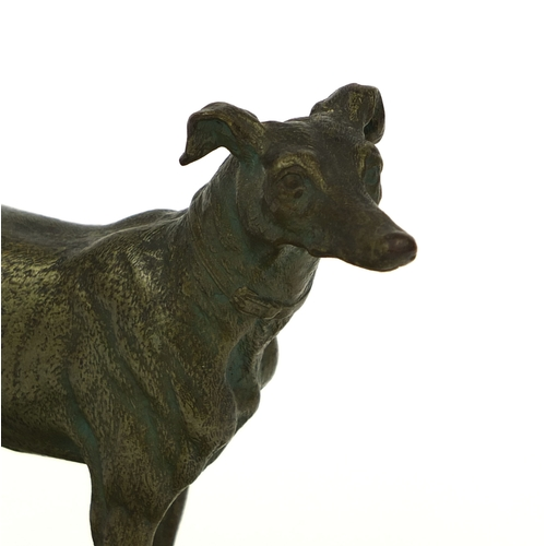 16 - Bronze study of a greyhound mounted on a green onyx ashtray base, 15cm high