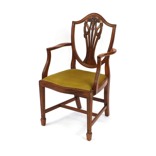 2028 - Yew twin pedestal D-end dining and six dining chairs including two carvers, each carved with The Pri...