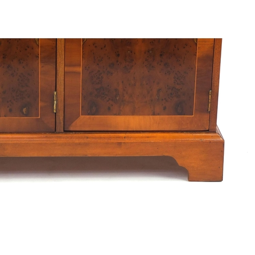 2029 - Inlaid yew sideboard fitted with three drawers above four cupboard doors raised on bracket feet, 80c...