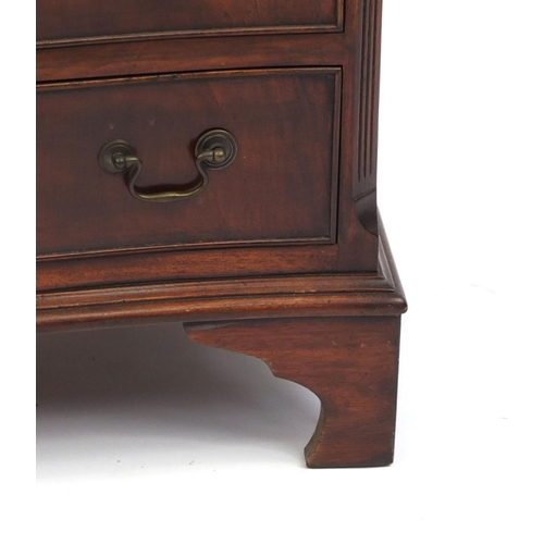 2054 - Reproduction mahogany serpentine fronted five drawer chest with brushing slide on bracket feet, 78cm...