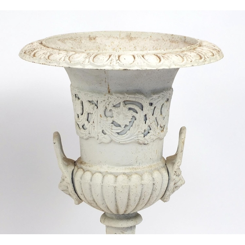 2012 - Pair of cast iron campana shaped urns on stands, with lion mask handles, 84cm high