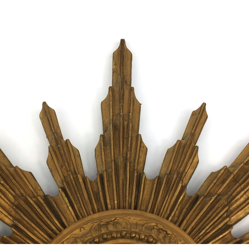 2023 - Vintage carved gilt wood sunburst design convex mirror, 56cm in diameter