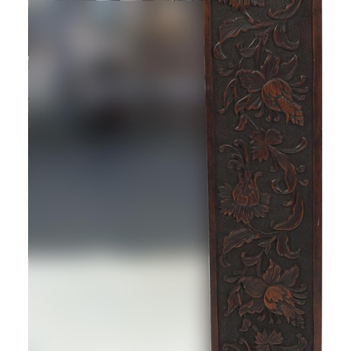 2039 - Large hard wood bevelled edged mirror carved with flowers and foliage, 166cm x 84cm
