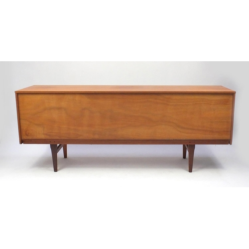 2022 - 1970s teak sideboard fitted with three drawers and a pair of cupboard doors, 72cm high x 181cm wide ...