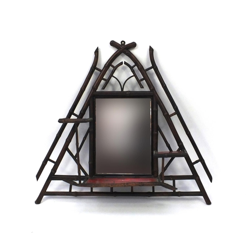 2047 - Aesthetic bamboo wall mirror and shelves of triangular form, hand painted with flowers, 67cm high